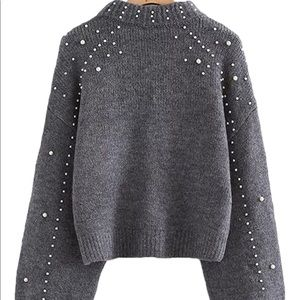 Silvia a grey pearl studded sweater runs small